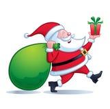 Santa Carrying Big Bag av gåvor arkivfoton