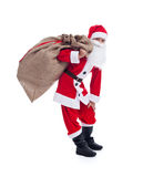 Santa carrying his large bag Stock Photography
