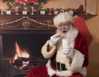 Santa carrying presents Stock Photo