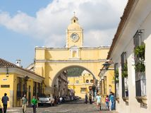 Santa Catalina Arch In Antigua. ANTIGUA, GUATEMALA - JANUARY 21: Street view of Santa Catalina Arch a popular tourist attraction in Antigua surrounded by people Stock Photography