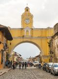 Santa Catalina Arch In Antigua. ANTIGUA, GUATEMALA - JANUARY 21: Street view of Santa Catalina Arch a popular tourist attraction in Antigua surrounded by people Stock Image