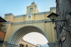 Santa Catalina Arch in Antigua. Close up to Santa Catalina Arch, the clock tower in Antigua, old historic city in Guatemala and a UNESCO world heritage site Stock Photography