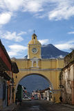 Santa Catalina  Arch on the background of volcano in Antigua Gua Royalty Free Stock Photo