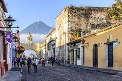 Santa Catalina Arch, ruins & Agua volcano, Antigua, Guatemala. Antigua, Guatemala - April 14, 2019: Locals make Palm Sunday procession carpet by Santa Catalina stock photography