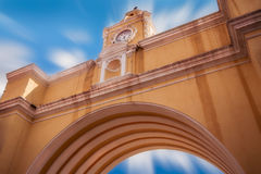 Santa Catalina`s Arch perspective in Antigua. Santa Catalina`s Arch against the blue sky with moving clouds in Antigua in Guatemala. Antigua was declared UNESCO Stock Photo