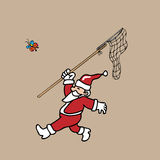 Santa catching butterfly by net Stock Photography