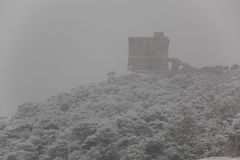Santa Caterina tower after a exceptional snowfall Stock Images