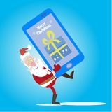 Santa cell phone gift. Santa Claus carries a mobile phone as a gift for the new year. Vector illustration of a flat style Stock Photo