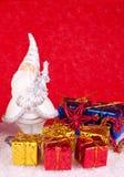 Santa ceramic figure on red background. Santa clause ceramic figure with presents on red background Royalty Free Stock Photos