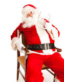 Santa in chair Royalty Free Stock Photography