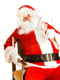 Santa in chair Stock Images