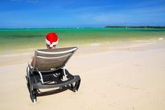 Santa on chaise longue on beach. Santa on chaise longue on caribbean beach stock photography