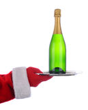 Santa with Champagne Bottle on Tray Royalty Free Stock Photos