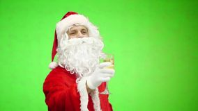 Santa with a champagne glass. Santa Claus holding a drink. Funny Christmas toasts. green background