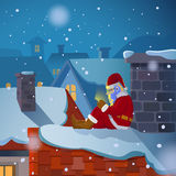 Santa chat on the roof Royalty Free Stock Images