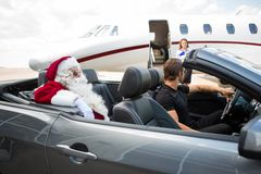 Santa And Chauffeur In Convertible While stock photo