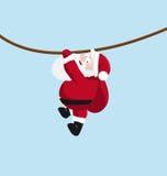 Santa che appende sulla corda Immagine Stock