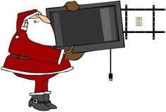 Santa che appende uno schermo piano TV Fotografie Stock Libere da Diritti