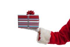Santa che dà i regali di Natale su bianco Fotografia Stock