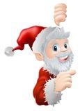 Santa che dà una occhiata e che indica Immagini Stock