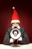 Santa che grida tramite il megafono Fotografie Stock Libere da Diritti