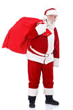 Santa che porta i presente Fotografia Stock