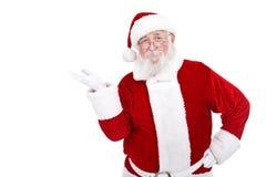 Santa che presenta prodotto Fotografia Stock