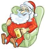 Santa che riposa in pigiami Fotografie Stock