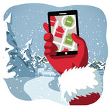Santa checks his GPS to see whos naughty or nice Royalty Free Stock Photos