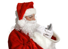 Santa Checks List on PDA Stock Photo