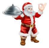 Santa Chef. An illustration of Santa Claus doing a chef's perfect sign with his hand and holding a covered tray of food Royalty Free Stock Images