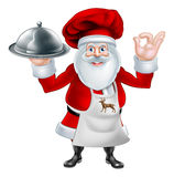 Santa Chef Christmas Dinner Concept Stock Photo