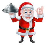 Santa Chef Holding Christmas Dinner Image stock