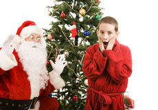 Santa and Child Christmas Surprise Stock Photos