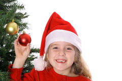 Santa child by Christmas tree. Shot of a Santa child by Christmas tree Stock Photos