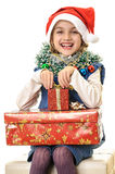 Santa child enjoying Christmas presents Royalty Free Stock Image