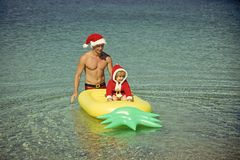 Santa child, father at Christmas.