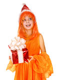 Santa child girl in orange costume, red gift box Stock Photos