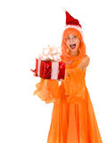 Santa child girl in orange costume, red gift box Stock Photography