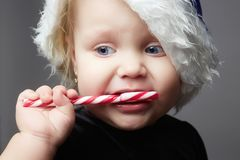 Santa child. happy kid with lollipop candy Stock Images