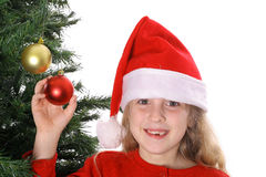 Santa child showing ornaments on tree Stock Photo