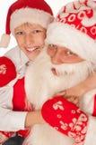 Santa with child on a white Royalty Free Stock Photos