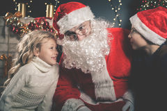 Santa and children around the decorated Christmas tree. Wishes list Stock Images