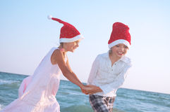 Santa children on the beach Stock Image