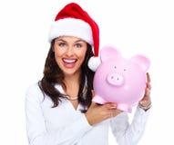 Santa Christmas affärskvinna med en spargris. Royaltyfri Fotografi