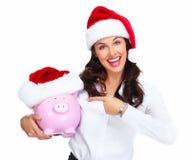 Santa Christmas affärskvinna med en spargris. Arkivbilder