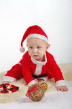 Santa Christmas Baby with ornaments Royalty Free Stock Photography