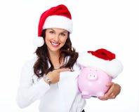 Santa Christmas-bedrijfsvrouw met een spaarvarken. Royalty-vrije Stock Afbeeldingen