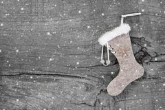Santa or christmas boot on a wooden shabby chic background for a Stock Photography