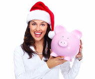 Santa Christmas business woman with a piggy bank. Royalty Free Stock Photography